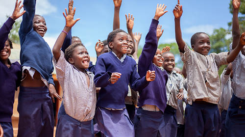 Children jumping, Zambia